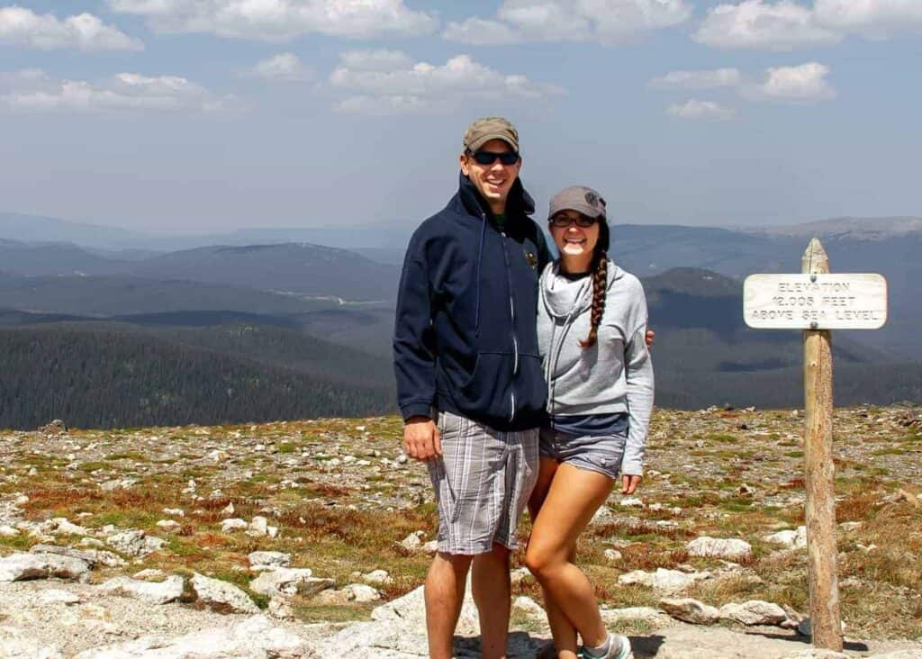 Scott and Taylor Woodworth smiling at the summit of a Colorado hike