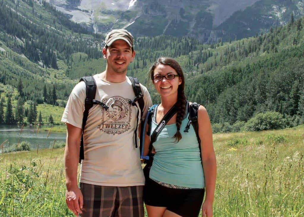 Scott and Taylor Woodworth posing in from of Maroon Bells outside Aspen, Colorado.