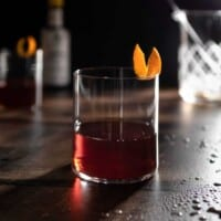 amaro old fashioned in a glass with an orange twist