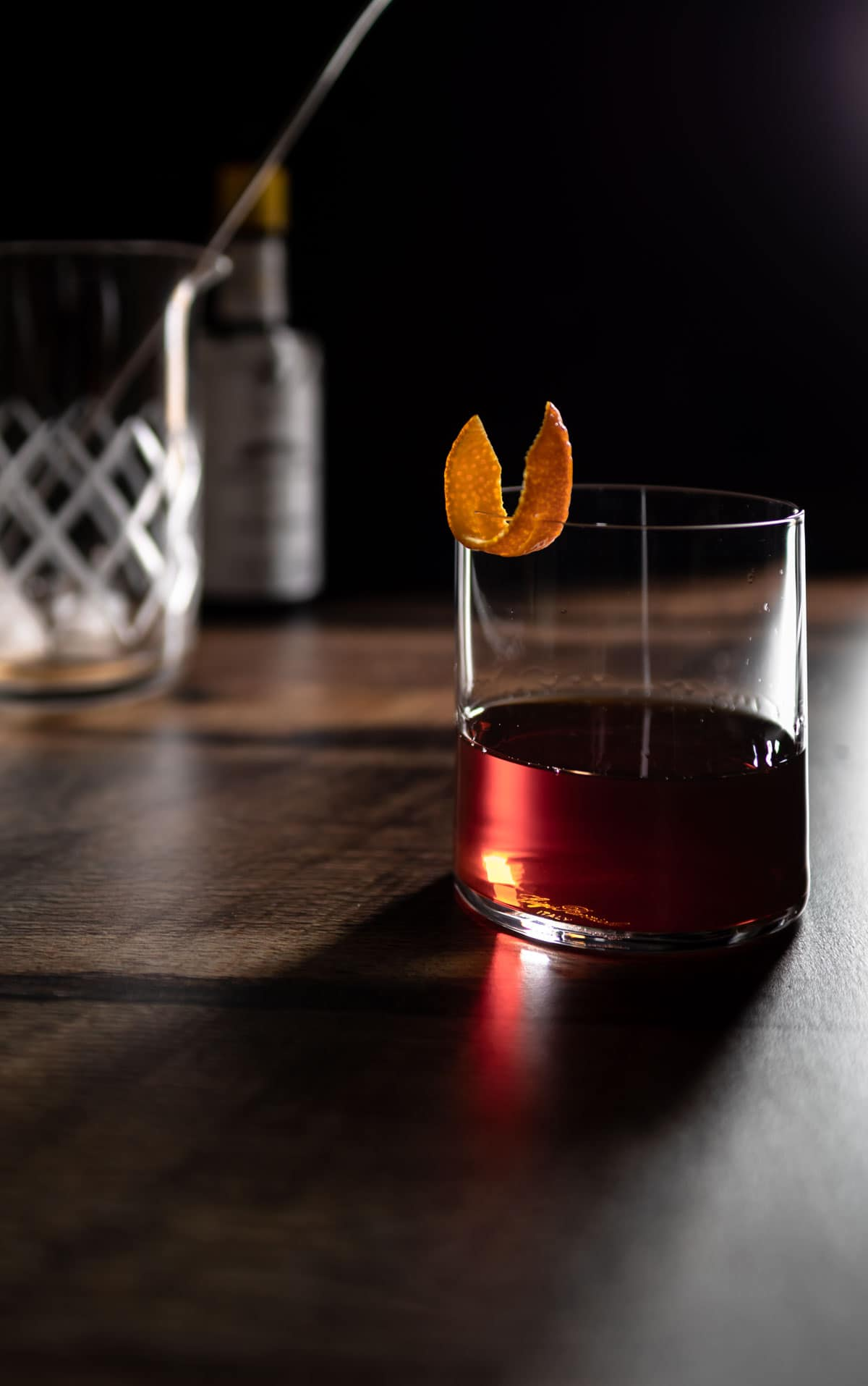 bitter old fashioned being served in a cocktail glass
