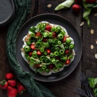 overhead view of cucumber strawberry salad