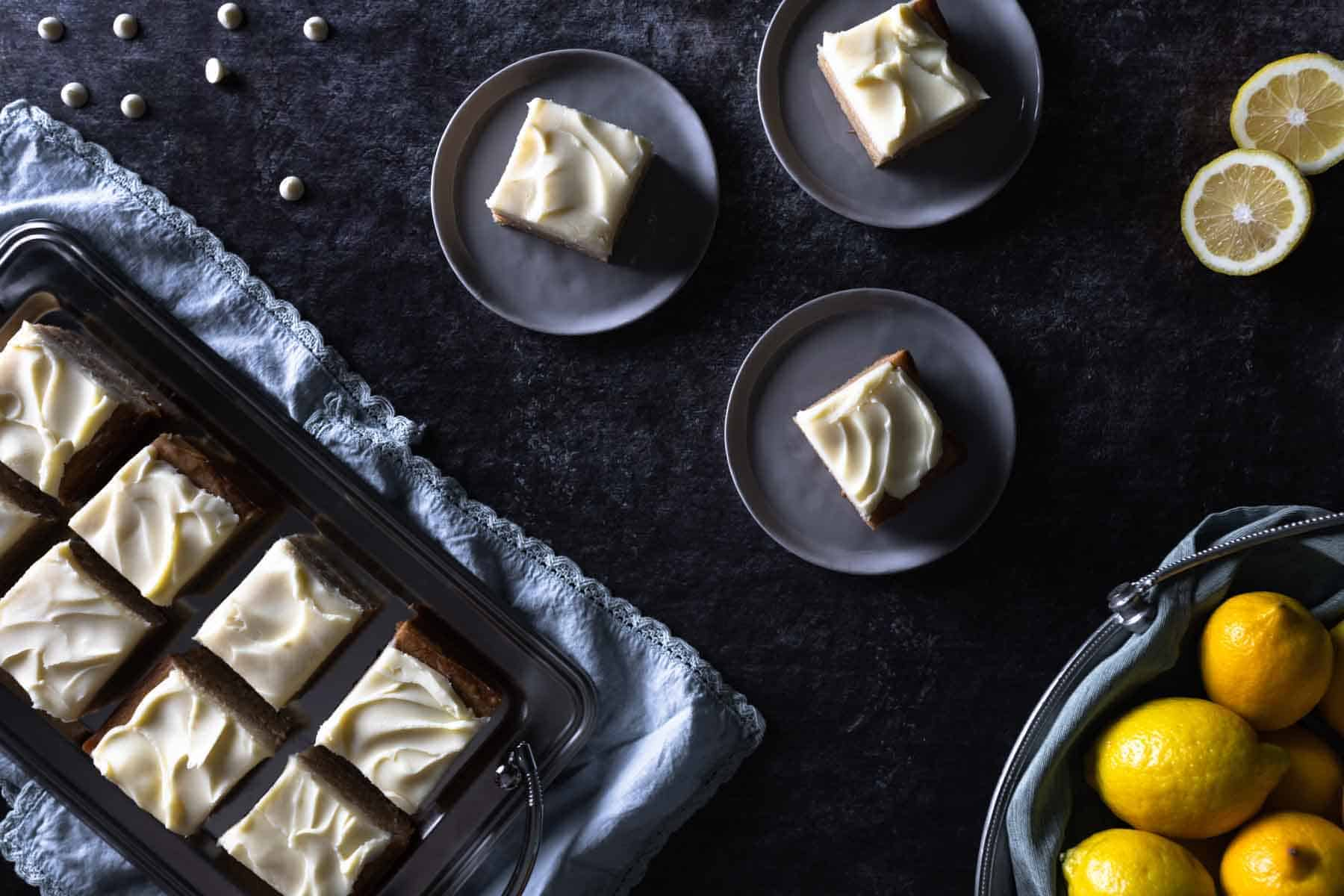 A tray full and several servings of Lemon Blondies with White Chocolate Ganache