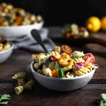 a bowl full of Halloumi Pasta Salad with a fork sticking out