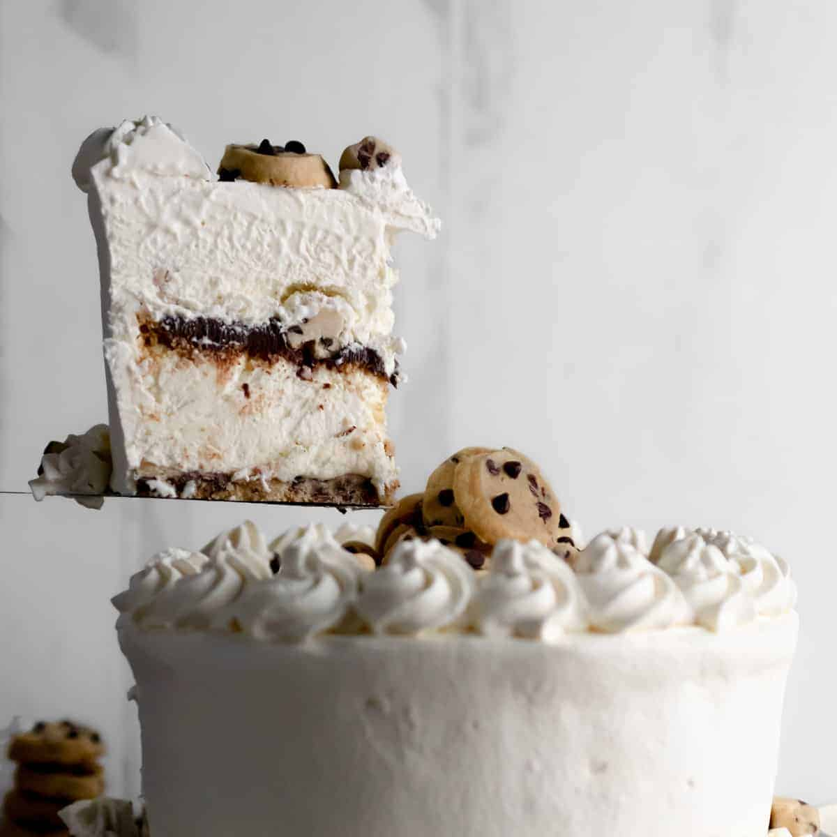 Lifting the first slice from the Cookie Dough Ice Cream Cake