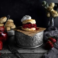 A Lavender Strawberry Shortcake on a tin stand